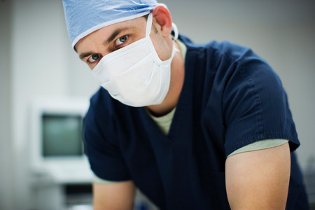 Surgeon in Operating Room prepping for surgery.