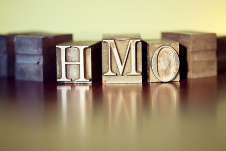 HMO spelled out with letterpress blocks.
