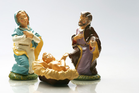 Nativity scene figurines on white background.