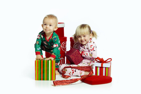 Kids and gifts opening Christmas gifts.