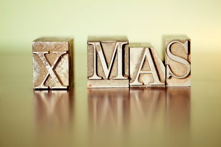 X-MAS spelled out with letter press blocks 스톡 콘텐츠