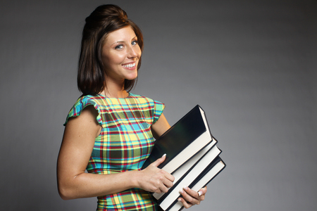 An attractive woman holding books