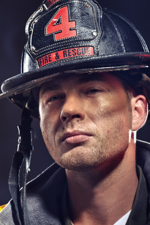 Portrait of a firefighter. Stock Photo