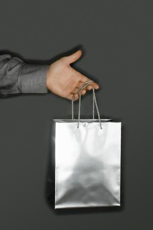 Man Holding a silver bag