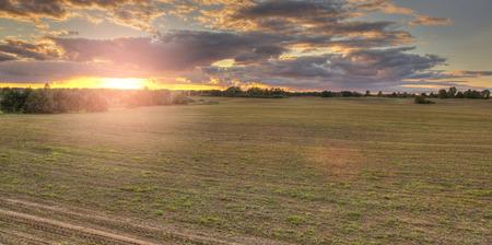 Warm sunset over farm fields.