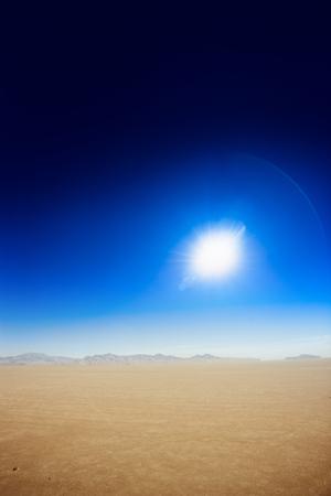 dry desert landscape with sun.