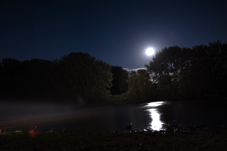 Night photo of river with fog and moonlight