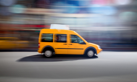 Yellow taxi zooming by. Stok Fotoğraf