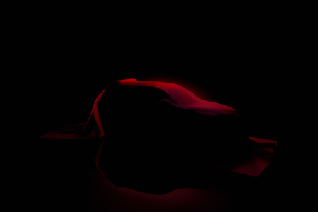 SUV-styled car under red drapery. New car concept.
