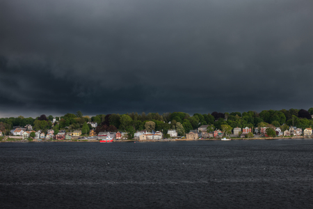 Coastal town in North Eastern USA, with storm clouds approaching.