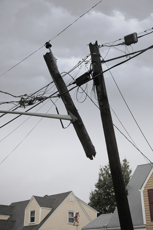 Utility pole snapped in half after a storm. Фото со стока