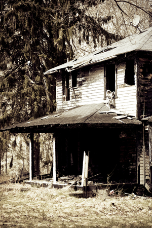 Photo of a house burned by a fire.