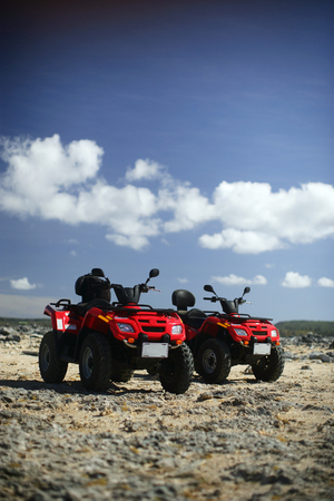 two quads on a rocky surface.