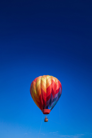 Tethered Hot Air Balloon and clear blue sky with copy space.
