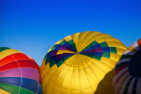 Detail of colorful Hot Air Balloons filling up with hot air before flight.