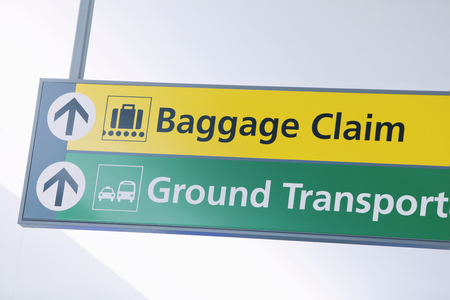Baggage Claim and Ground Transportation sign at international airport.
