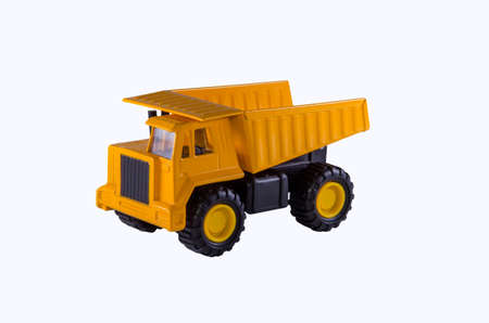dump truck: Childrens toys yellow dump truck on a white background