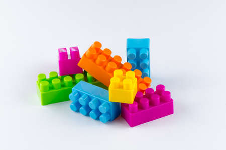 yellow lego block: Plastic building blocks on a white background