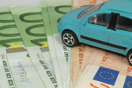 A car and cash Stock Photo