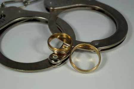 Wedding rings and handcuffs
