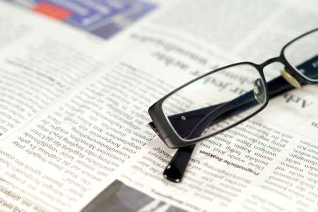 science text: A newspaper and a pair of glasses