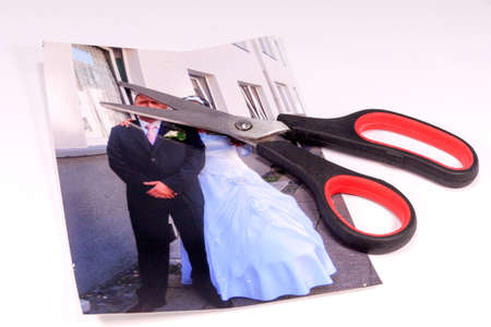 adultery: Wedding photo and a pair of scissors