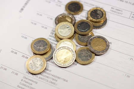 indebtedness: Account statement and coins Stock Photo