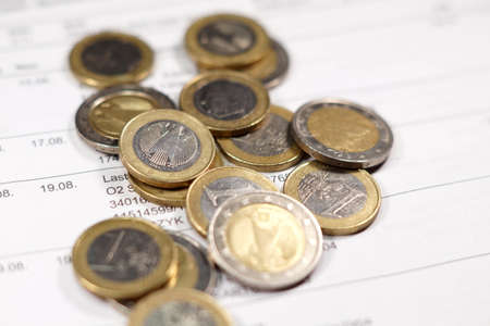 bankcard: Account statement and coins Stock Photo