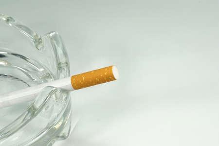 A cigarette in the ashtray
