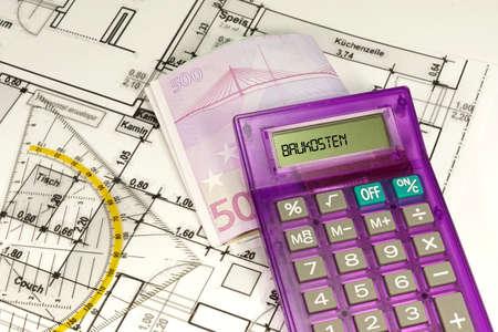 draftsman: Construction costs calculator Stock Photo