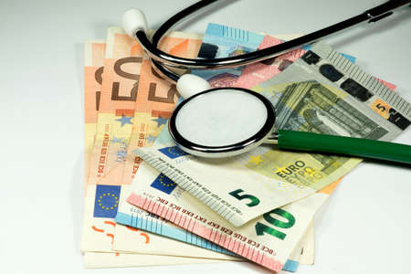 medical expenses: Stethoscope and money