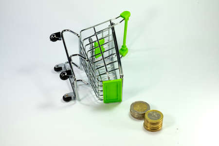 shopping trolley: money and shopping trolley Stock Photo