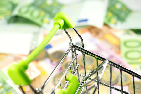 hard sell: Shopping cart and cash