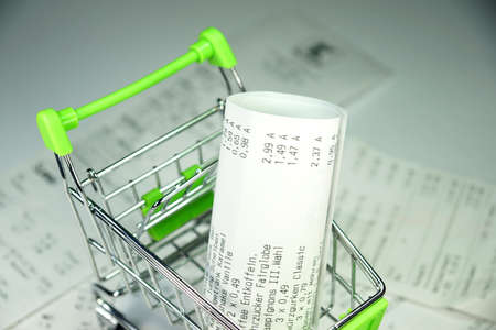 cash slips: Shopping cart and receipts
