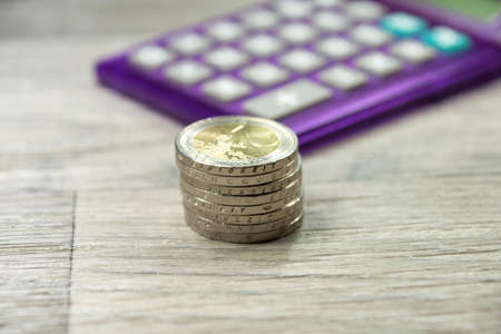 indebtedness: Euro coins and calculator