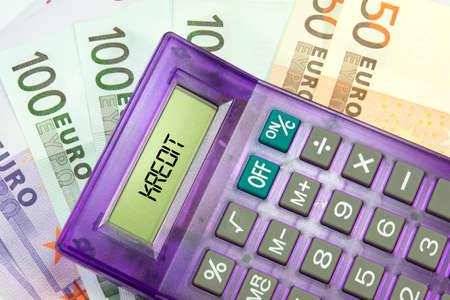 Cash, calculator and credit