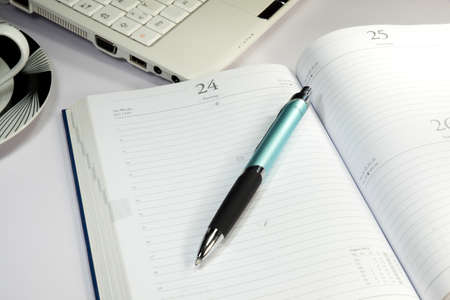 appointment book: An integrated scheduler on an office table Stock Photo