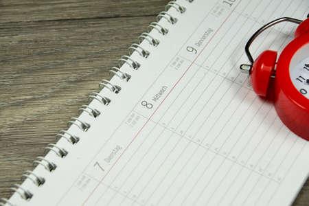 career timing: Alarm Clock and Calendar Stock Photo