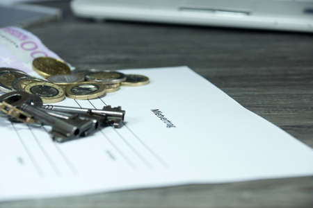 Renting: keys and money on the contract of renting an apartment