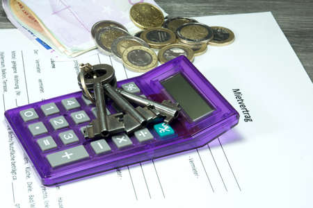 calculator and keys on the contract of renting an apartment Stock Photo