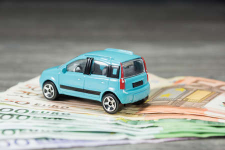 car on the money file Stock Photo