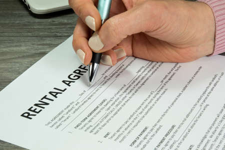 A woman fills a lease from