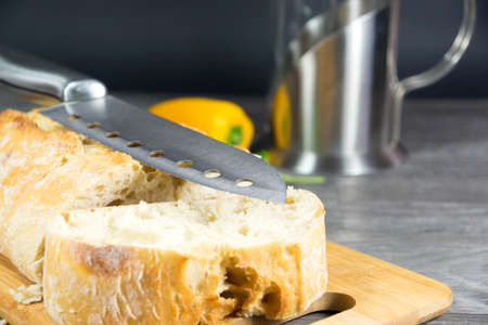 countertop: Kitchen knife on the bread
