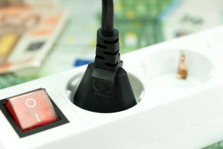 electricity providers: Electrical socket and money