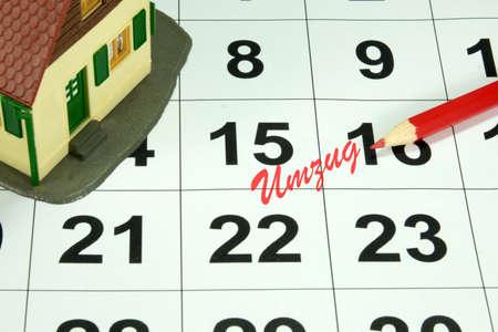 scheduler: A calendar and a moving date Stock Photo