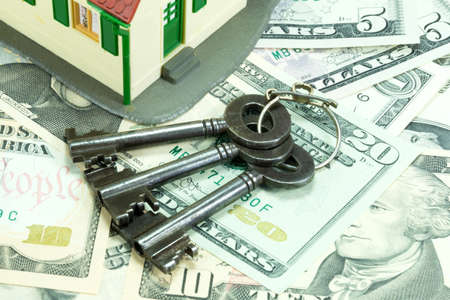 attributable: Money, keys and a house Stock Photo