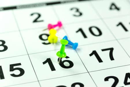 scheduler: Calendar and colorful thumbtacks