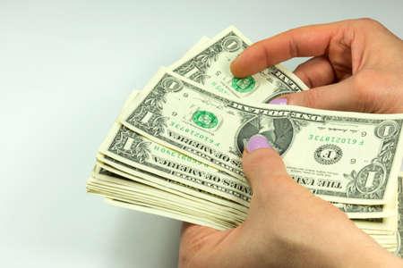 counts: A woman counts money