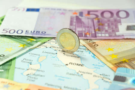 Euro money and map of Italy Imagens
