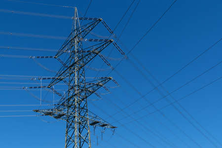 electricity prices: Power pole and blue sky